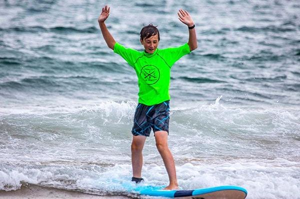 Student-practices-surfing-before-entering-the-water