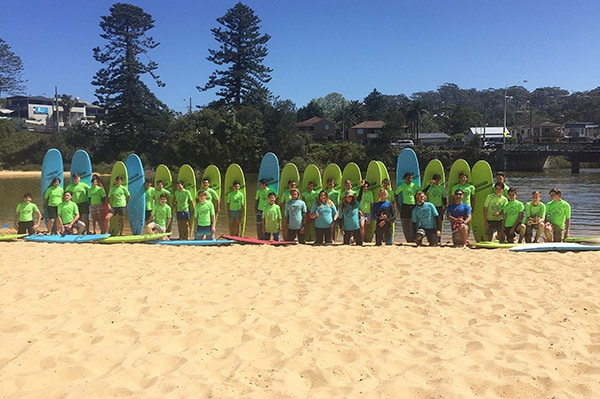 Wamberal-Beach-class-pose-for-photo-with-surf-boards