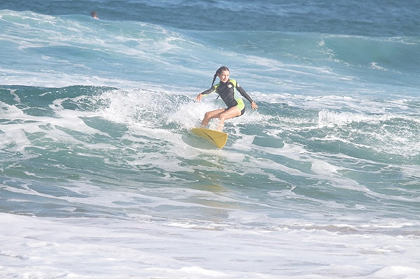 Younger-female-surfer-rides-a-wave-1